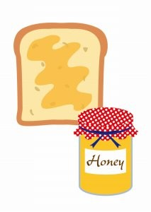 ハチミツの瓶と食パン