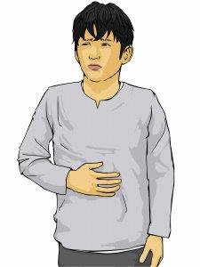 胃もたれする男性