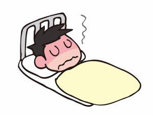 熱を出して寝込む男性